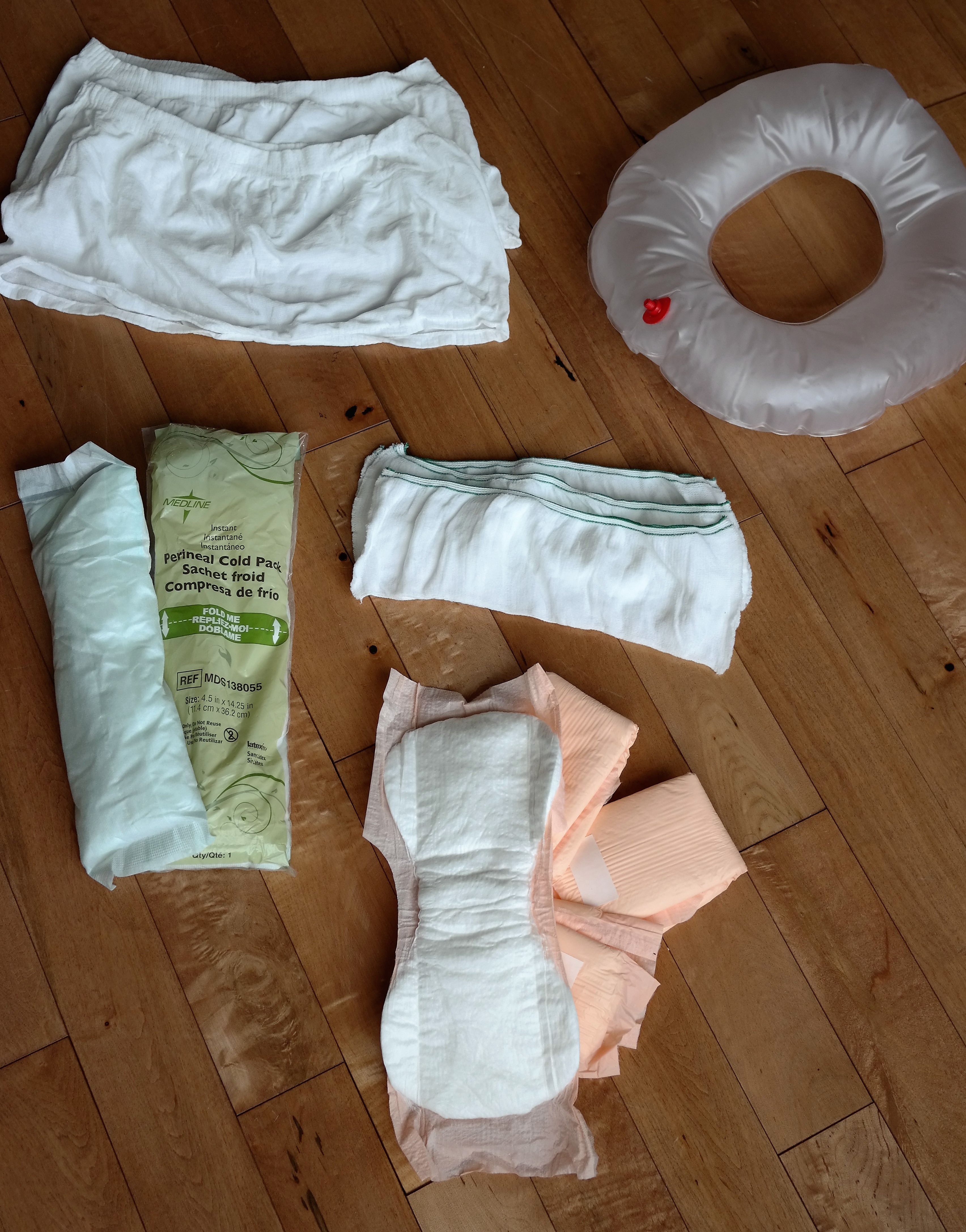 Items provided by hospital for postpartum care, Boyshort disposable panties, inflatable donut seat cushion, Perineal Cold Pack, rectangle disposable panties, peach pad